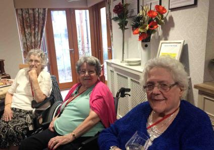 Residents Joyce, Elizabeth and Pam enjoying a drink whilst watching the bowling