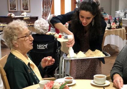 Meyrick Rise Care Home, Dorset-Healthcare Assistant Jessica serving a selection of sandwiches