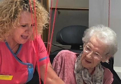 Meyrick Rise Care Home, Dorset-Magic Moments Club Assistant Leanne presents resident Addalane with one of her two cakes!