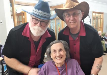 Meyrick Rise Care Home, Bournemouth-Resident Joan with the delightful gents from 'Fossil Pops'