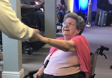 Meyrick Rise Care Home, Dorset-Resident Joyce enjoying the music