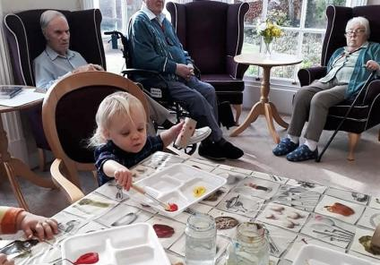 Ross Court Care Home enjoyed a visit from the local nursery for Chinese-inspired crafts and games. Residents Peter, Des and Barbara enjoy crafts with the children