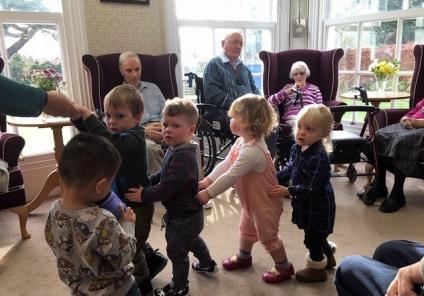 Ross Court Care Home enjoyed a visit from the local nursery for Chinese-inspired crafts and games. Residents Peter, Des and Mary enjoy the children's version of the 'dragon dance'!