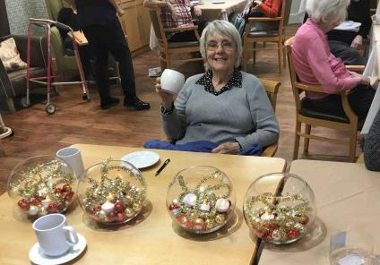 Resident Wini at Scarborough Hall creating some lovely festive decorations!