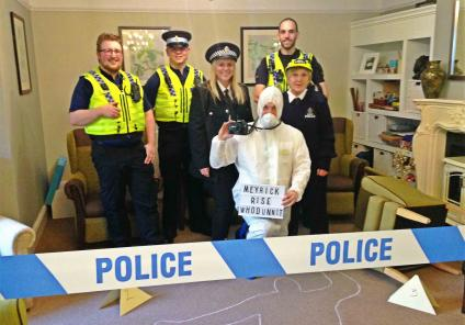 Meyrick Rise in Bournemouth solved a murder by completing puzzles riddles and challenges, with help from the Dorset Police. Magic Moments Club team Ronnie and Vicki and receptionist Martin with the Dorset Police and neighbourhood team