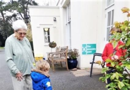 Ross Court Care Home, Herefordshire- Resident Pam helps little Archie on our egg hunt