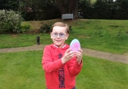 Ross Court Care Home, Herefordshire-Liam finds one of the Easter eggs in the garden