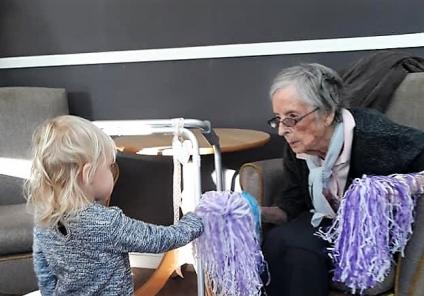 Resident Gladwys helps Mia get to grips with the pom-poms for our exercise session