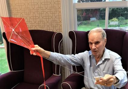 Resident Peter Stock enjoying our kite making craft session
