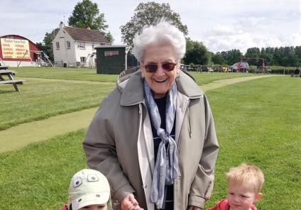 Ross Court Care Home, Herefordshire-Smiles in the sunshine. Resident Pam with Archie and Harlan