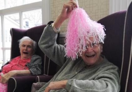 Ross Court Care Home, Herefordshire-Resident Barbara laughs as Pam plays hide and seek with a pom pom!