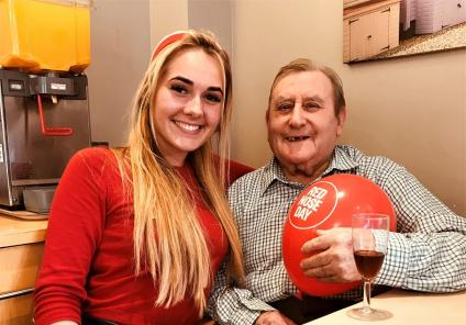 Scarborough Hall Care Home, North Yorkshire. Team member Keavy and resident Jim are all smiles on Red Nose Day