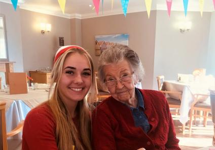 Scarborough Hall Care Home, North Yorkshire. Team member Keavy and resident Sheila enjoying Red Nose Day