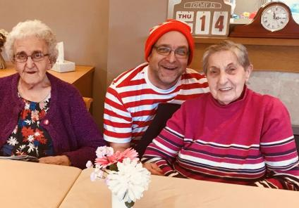 Scarborough Hall Care Home, North Yorkshire. Team member Keavy, resident Eileen, team member Andrew and resident Sheila
