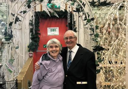 Residents Wini Whilde and Gordon Smith amongst the Christmas decorations