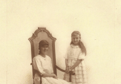 Mary and her older sister Marjorie posing for a photo.