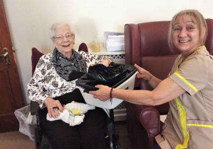 Glebefields Care Home in Banbury spent the day working out who stole the home manager's tiara by completing sensory activities to find the clues! Resident Sheila searching for the clue hidden in sensory beads with Housekeeper Angela