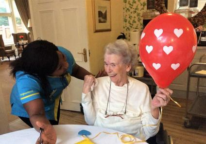 The Berkshire Care Home, Wokingham. Carer Habiba and resident Muriel having fun