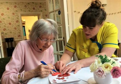 The Berkshire Care Home, Wokingham. Resident Jessie and Senior Carer Zoe making Valentine's Day cards