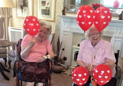 The Berkshire Care Home, Wokingham. Residents Mollie and Josie with our love heart balloons