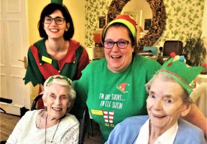 The Berkshire's elves have a giggle - Residents Marcel and Muriel with Receptionist Rubina and Carer Clair