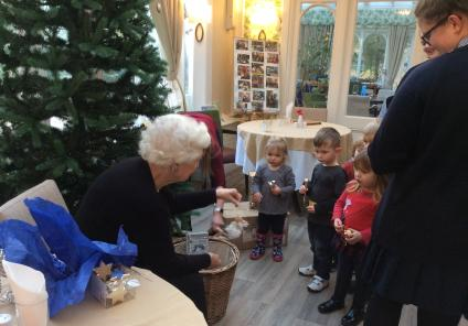 Joy picks out a Fairy for the children to put on the Christmas tree
