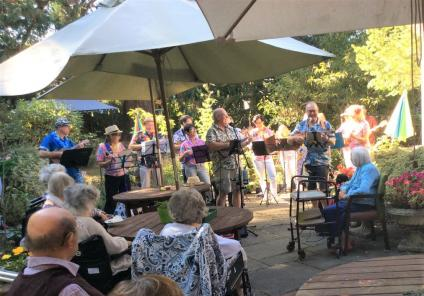The Berkshire Care Home, Wokingham-Residents and guests enjoying live music in the garden after our harvest lunch