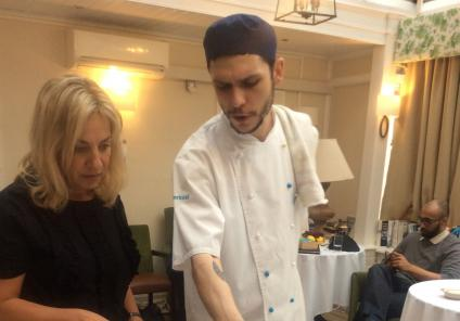Our chef Robert describing his Greek creations to Myrtel's granddaughter Nicki