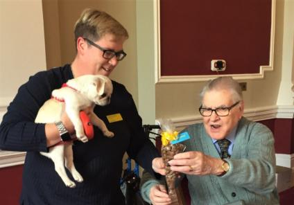 The Granby Care Home, Harrogate-Ollie the Pug puppy and his owner Kelly are presented with the award for 'Heartbreaker'