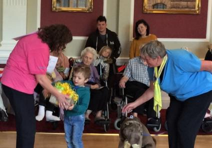 The Granby Care Home, Harrogate-Team Member Briony awards Corey with the prize for Best in Show for his grandma's dog Baloo