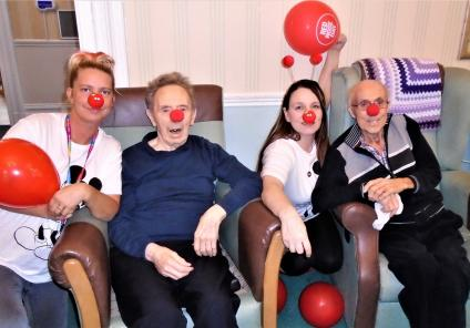 The Grange Care Home, Lancashire. Team member Emma, resident Jack, team member Kelly and resident Fred ready to raise money for Comic Relief