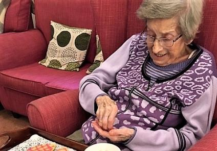The Lawns Care Home, Leicestershire. Resident Gerda decorating heart-shaped biscuits