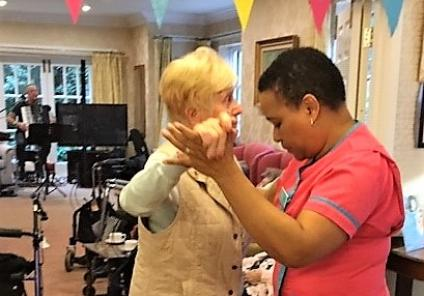 The Lawns Care Home, Leicestershire. Resident Norah enjoys a dance with Magic Moments Club Coordinator Rose to live music by Roger Filkins