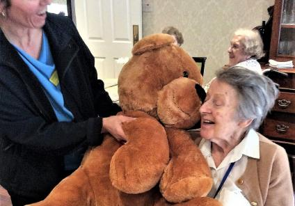 The Lawns Care Home, Leicestershire. Resident Rene wins our Valentine bear and gives him a cuddle!