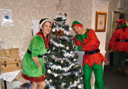 The Grange's elves Kelly and Michael and their Christmas tree!