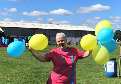 Westbury Court Care Home, Wiltshire-Magic Moments Club Coordinator Suzanne ready with her balloons!
