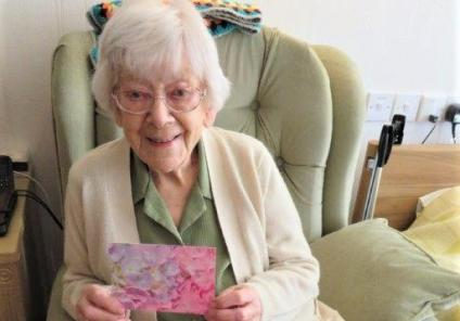 Westbury Court Care Home, Wiltshire-Rena with her pretty card from young Amelia