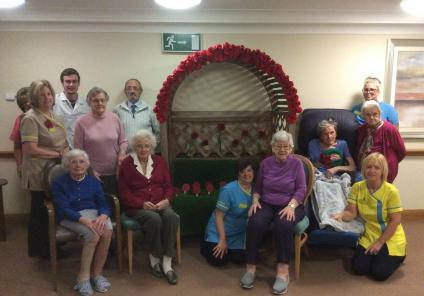 Residents and team members with our poppy bench