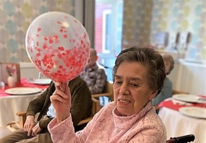 Wheaton Aston Court Care Home, Stafford. Resident Jo enjoying our Valentine's Day entertainment and lunch