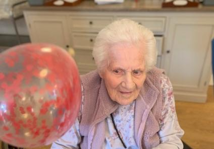 Wheaton Aston Court Care Home, Stafford. Resident May playing bat the balloon at our Valentine's lunch