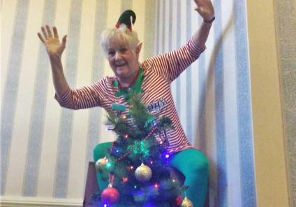 The elves at Avery House are making the home festive - Magic Moments Club Co-ordinator Deb Andrew puts the start on the tree