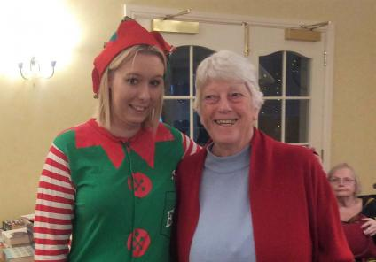 Resident Maureen enjoys the day with Alison, Magic Moments Club Co-ordinator