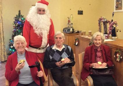 Residents Maureen, Ernie and Joan enjoy their cupcakes with Father Christmas!