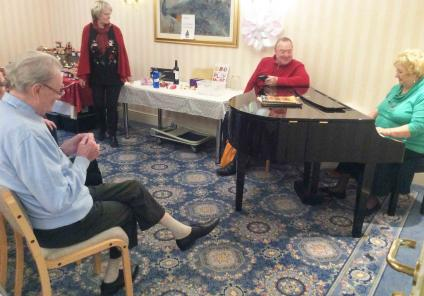 Everybody enjoyed singing along to volunteer Doreen on the piano!