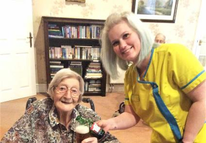 """""""Cheers"""" to resident Joyce's new bar at The Lawns Care Home in Oadby"""