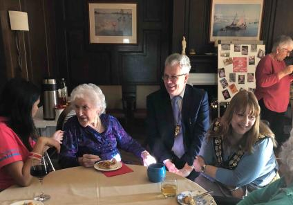 Hungerford Care Home in Berkshire had an 'International Mystery Food Festival'. Resident Audrey samples the food with Magic Moments Club Co-ordinator Kanika, Deputy Mayor Keith Knight and Mayor Helen Simpson.