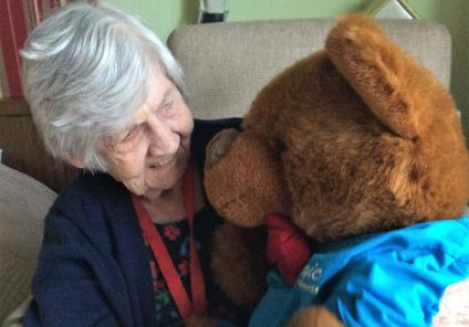 Tewkesbury Fields Care Home were tasked with finding their missing mascot Alfie! Found at last - resident Nancy is happy to see Alfie the teddy mascot again