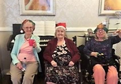 St Oswalds are feeling festive this Elf Day! Residents Joyce, Hannah and Eileen show off their festive hats