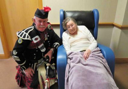 Westbury Court Care Home had a special performance from bagpipe player  Bob MacNaught. Here he is with resident Thelma