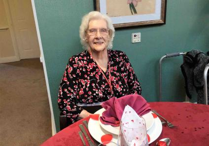 Glebefields Care Home in Banbury put on a wonderful Valentine's lunch. Resident Vera sitting at the beautifully made table!